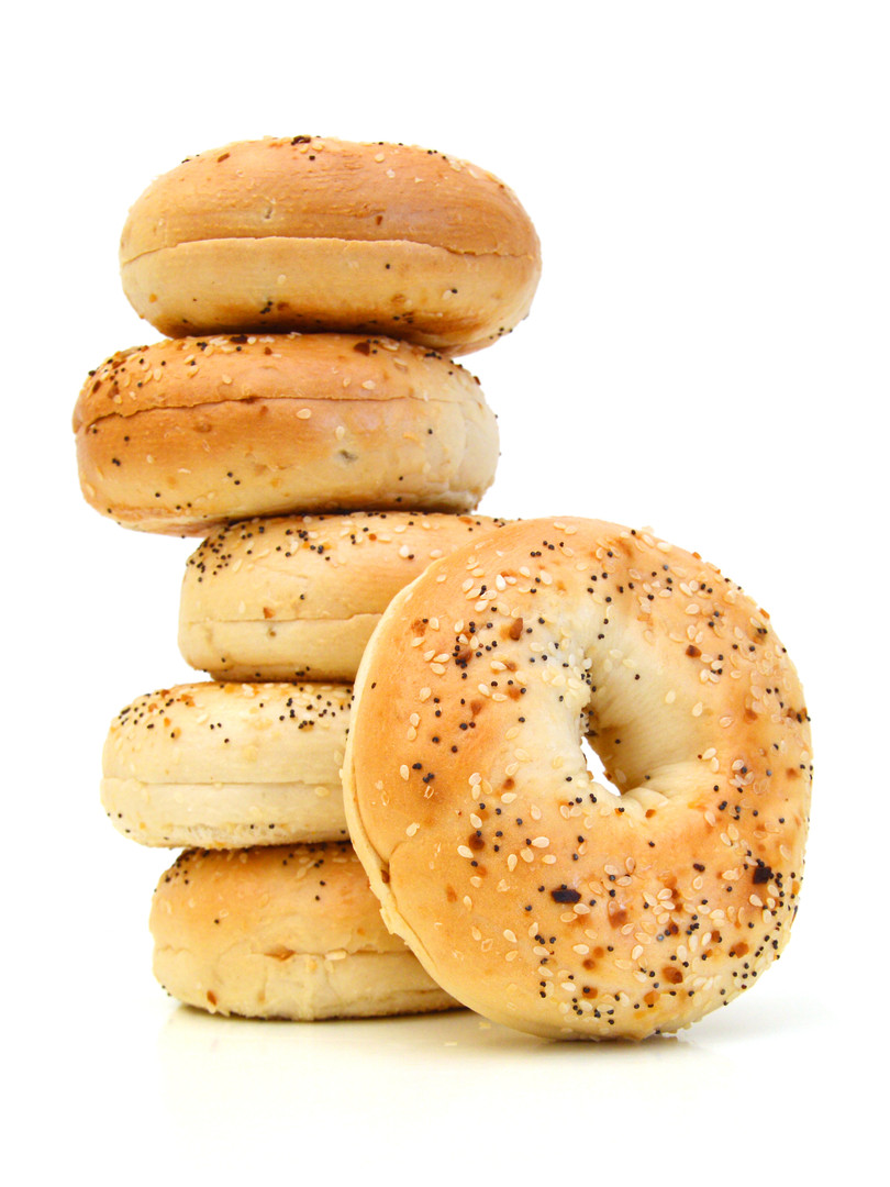 Stack sesame bagels on white background
