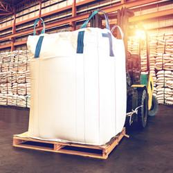 Forklift handling jumbo sugar bag for st