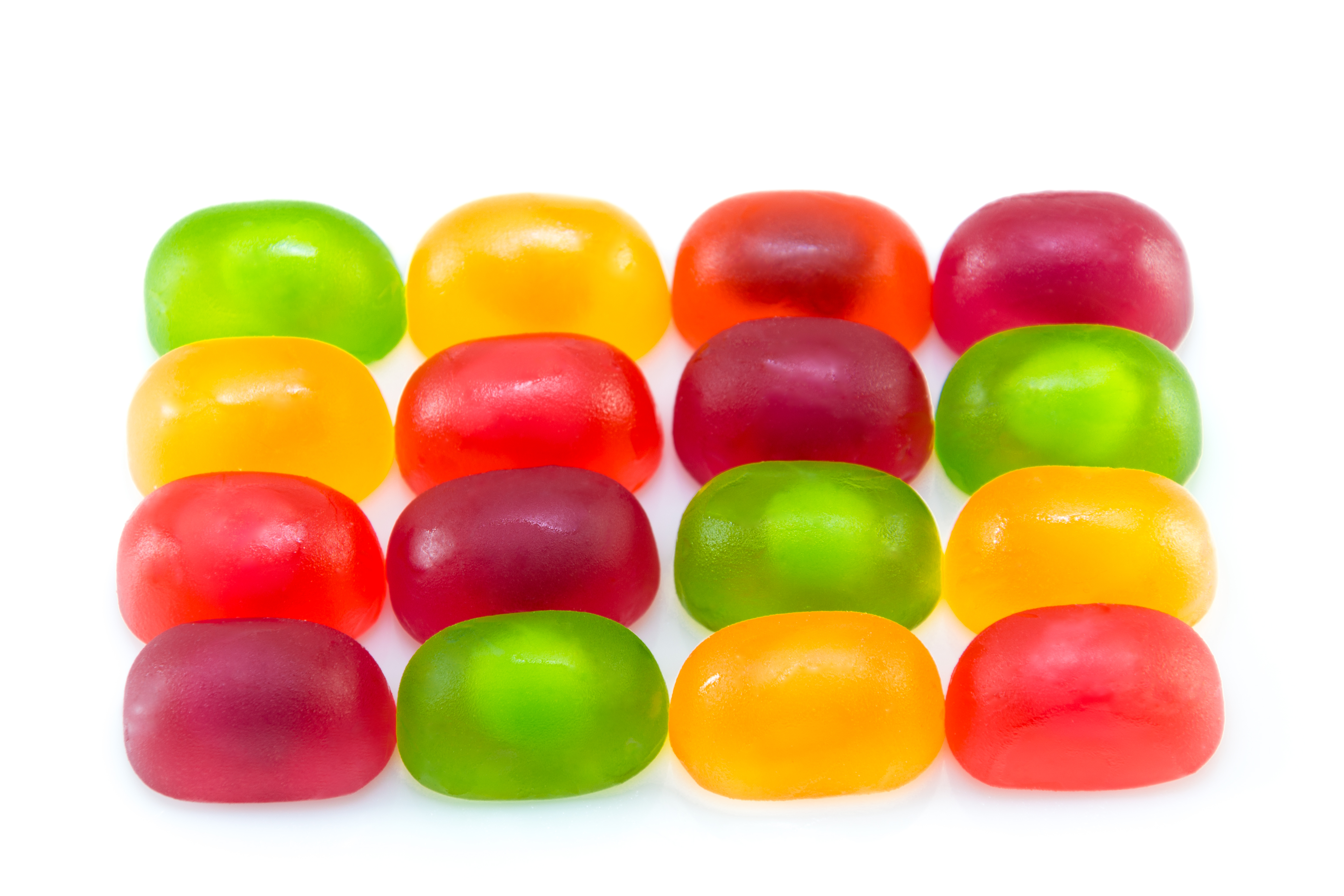 Fruit gummi or jelly candies assortment on white.
