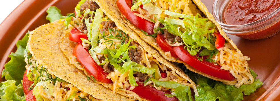 Closeup of beef tacos served with salad
