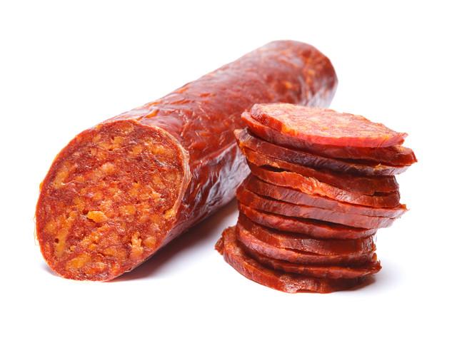 Spanish chorizo sausage on white backgro