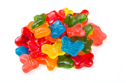 Sugar free gummy butterflies isolated on a white background
