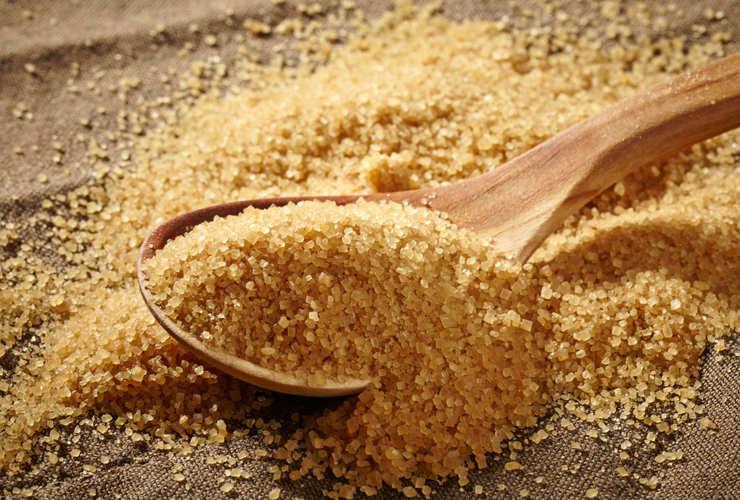 brown sugar heap and wooden spoon .jpg