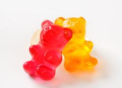 three gummy bears on a white background