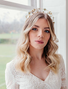 Bride wearing a celestial headpiece with stars and moons