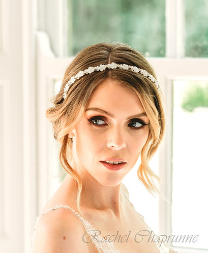 Simple bridal headband with flowers for a classic bride