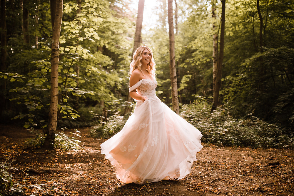 woodland wedding with bride in a flowing tulle and lace dress
