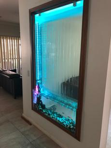 Custom in wall room divider waterfall and Aquarium