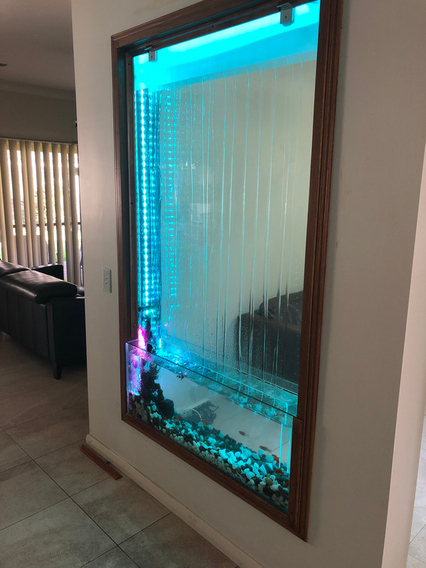 Custom in wall room divider waterfall and Aquarium