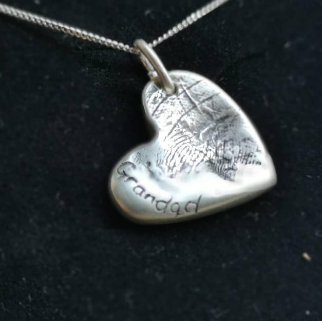 Double sided heart pendant