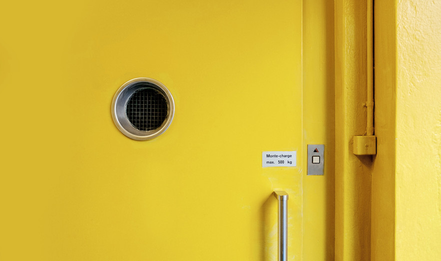 Yellow Door with Circle - Buildout Pro