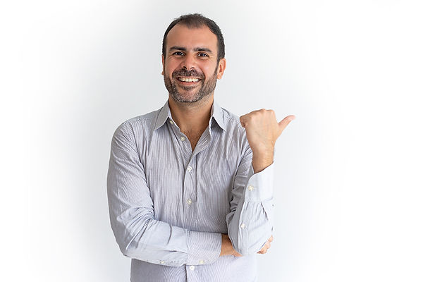 happy-optimistic-handsome-latin-sales-manager-pointing-aside-looking-camera copy.jpg