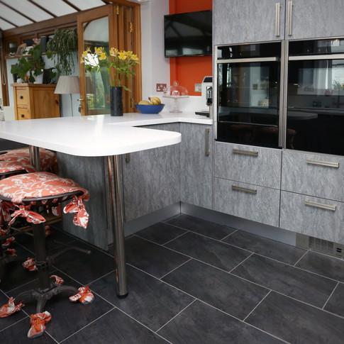 Orange highlight with Syncron Ice grey kitchen