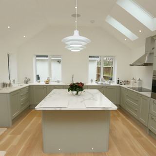 Solid surface kitchen with quartz island