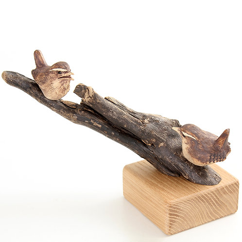 pair of wrens mounted on an oak base