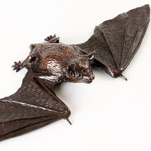 pipistrelle bat with wings almost unfolded, ready for flight - bronze