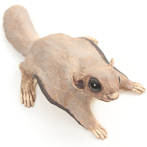 flying squirrel looking right - stoneware pottery
