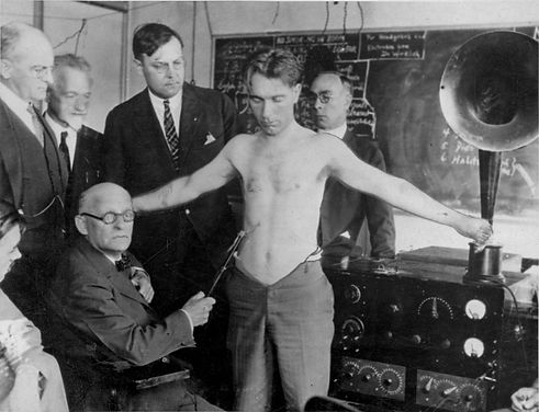 Dr. Abrams Demonstrating Early Radionic Diagnosis Using Abdominal Percussive Testing.