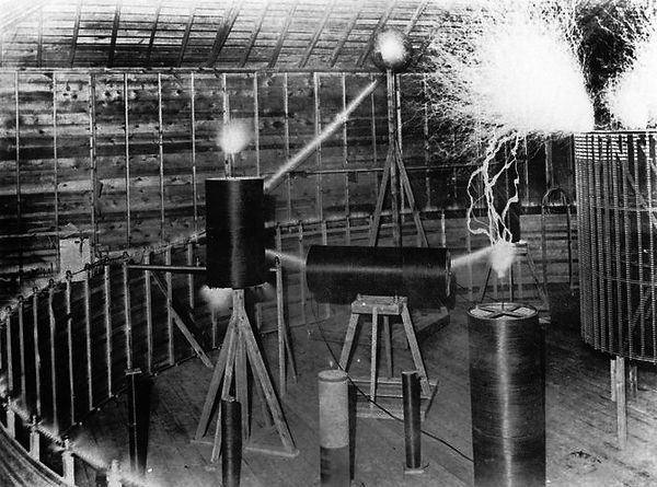 An experiment demonstrating resonance, conducted by Tesla at his Colorado Springs laboratory in 1899-1900 using his magnifying transmitter, a huge Tesla coil.