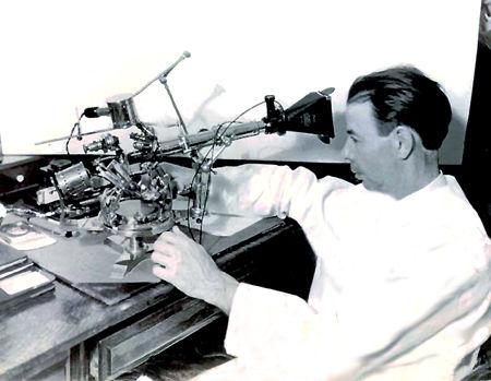 Dr. Royal Raymond Rife, Jr. at his microscope