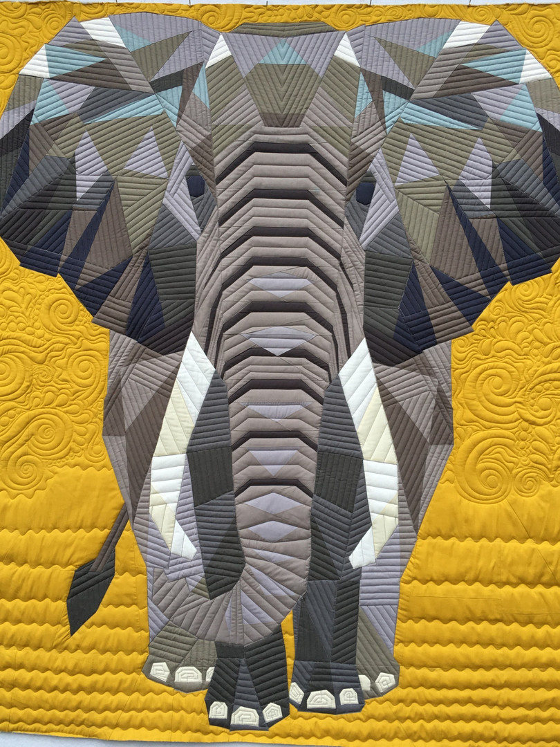 Custom quilted elephant quilt