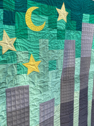 Custom quilted NYC skyline baby quilt