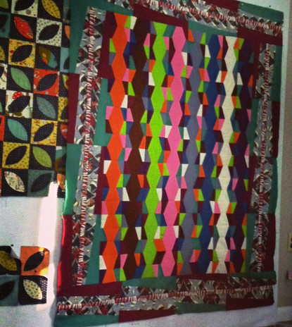 Custom quilts on the design wall