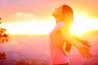 lady freely basking in sunrise
