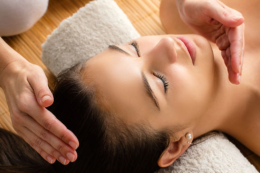 A lady receiving Reiki on her head