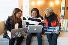 Canva - Three Woman in Front of Laptop C