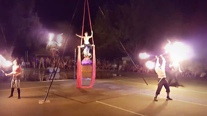 Mobile circus entertainmet aerial silks fire breathing fire spinning