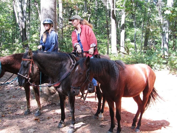 Amy riding Cowgirl and ponying her mustang colt Nacoma