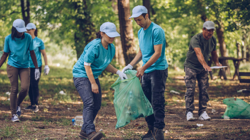 Group picking up trash in local park