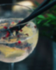 clear-wine-glass-with-liquid-in-focus-ph