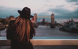 Thrive Future, young woman in hat, Tower Bridge London, Graduate, Graduate Programme for Mercer UK, Top 100 Graduate Programmes