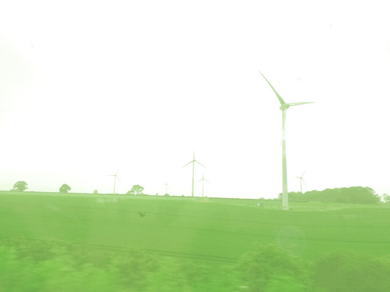 Windmills in UK Green landscape representing the madness of seeking your dreams
