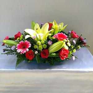 Casablanca Lilies, Red Roses, Gerbera, Purple Peacock, Green Chrysanthemum Pompom & Leaves