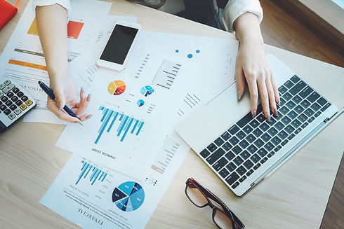 reviewing financial reports to improve business and bookkeeping strategies