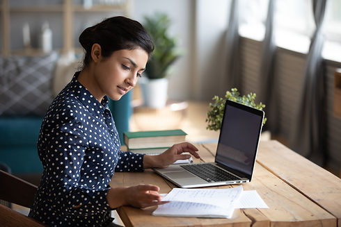 woman on computer updating her bookkeeping to decide if she needs bookkeeping services