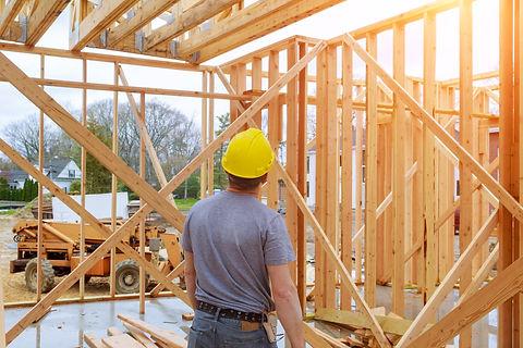 Builder looking at new home framing.jpg