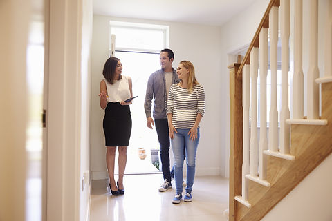 Realtor Showing Young Couple Around Property For Sale.jpg