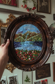 Hand-embroidered mountain scene