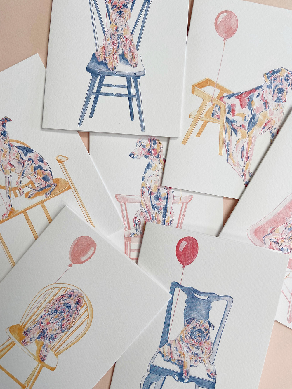 Colourful drawings of dogs on chairs with balloons. Birthday cards.