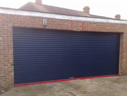 Large-blue-double-garage-door-400x300.jp