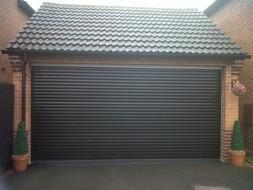 Large-black-green-roller-garage-doors-.j