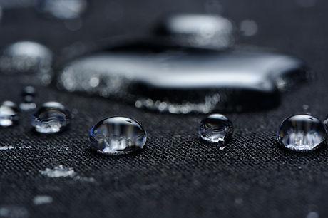 Water Drops on Waterproof Fabric Macro.j