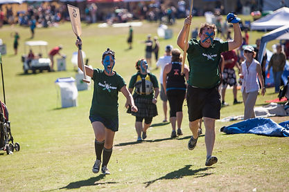 Two Dragonboat Paddlers Run through the Tents at Portland Dragon Boat Races