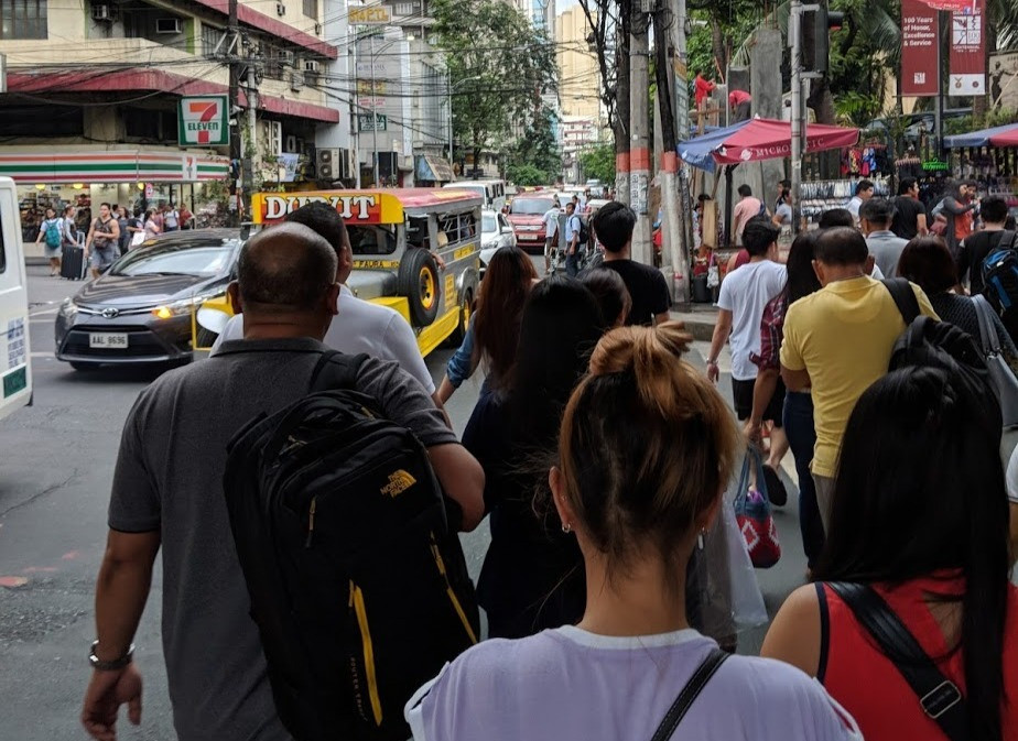 Image of people on a busy street of a city in the Philippines