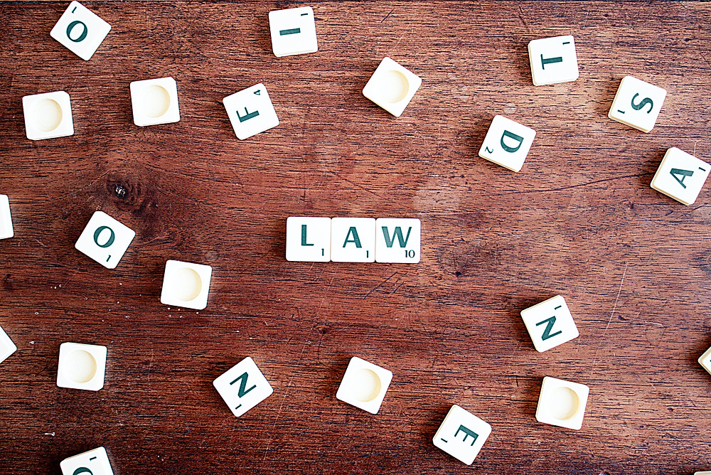 Scrabble letters put together to form the word law