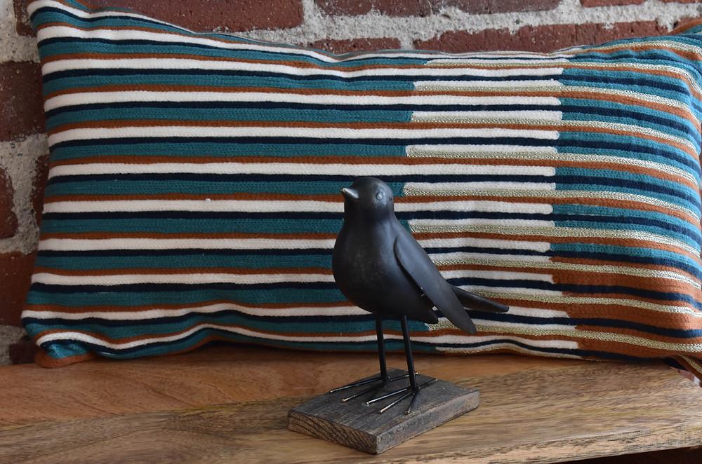 Striped rectangular pillow with rustic blackbird